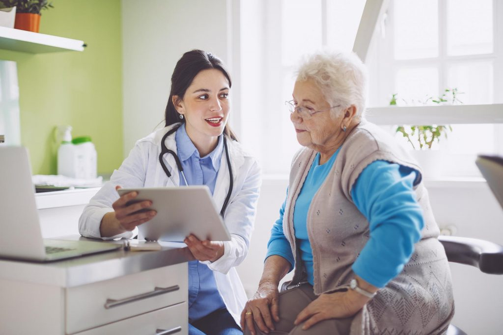 Doctor reviewing care coordination plan